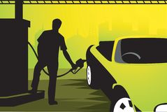 Man refuelling. Silhouette man refuelling fuel to a sports car in a fuelling station Royalty Free Stock Photo