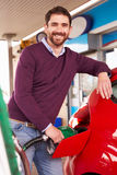 Man refuelling a car at a petrol station Royalty Free Stock Image