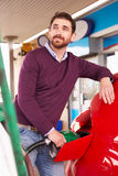 Man refuelling a car at a petrol station Royalty Free Stock Photography