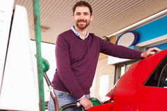 Man refuelling a car at a petrol station Stock Photography