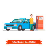 Man refuelling his car at petrol station. Man refuelling his car holding fuel hose at petrol station. Flat vector illustration  on white background Stock Photos