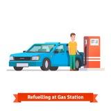 Man refuelling his car at petrol station Stock Photos