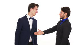 Man refuses to shake hands with his business partner - studio shot. Man refuses to shake hands with his business partner stock footage