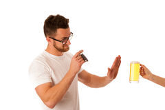 Man refusing alcohol beer showing car key as gesture of don`t dr Royalty Free Stock Image