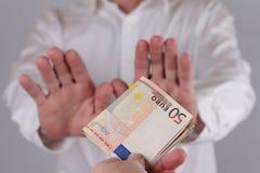 Man Refusing Money. Corruption, bribe concept Stock Images