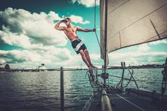 Man on a regatta Royalty Free Stock Image