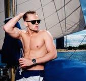 Man on a regatta Stock Photography