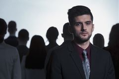 Man rejected from the crowd. Sad young men rejected from the crowd Royalty Free Stock Photos