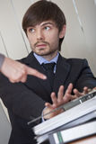 Man rejecting office work Stock Photo