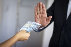 Man rejecting Peruvian money offered by a woman royalty free stock photos