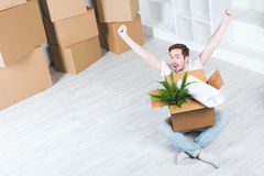 Man rejoices in buying a new home. Stock Photo