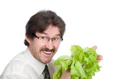 Man rejoices sheet of the salad Stock Images