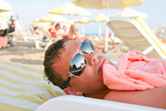 Man relax on the beach. Man in sunglasses relax on the beach Royalty Free Stock Image
