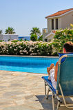 Man relax on deck chair Stock Image