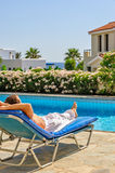 Man relax on deck chair stock photography
