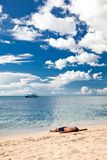 Man relax on sand at lonely beach Royalty Free Stock Photography