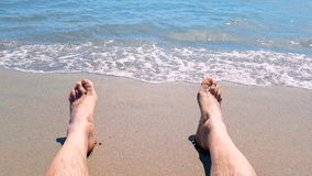 Man in relax stay with his feet on tropical caribbean beach sea with gold sand, holiday, relax and travel stock video footage