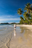 Man relax  on the tropical beach costline. Man relax walking on the tropical beach costline distance Royalty Free Stock Image