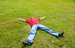 Man relaxation. On a green grass Royalty Free Stock Photo