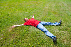 Man relaxation on a green grass Royalty Free Stock Images