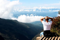 Man relaxes on the edge of the cliff . Plateau  End of the World  , Sri Lanka Royalty Free Stock Photography