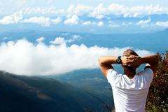 Man relaxes on the edge of the cliff . Plateau  End of the World  , Sri Lanka Royalty Free Stock Image