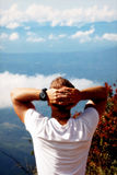 Man relaxes on the edge of the cliff . Plateau ` End of the World ` , Sri Lanka Stock Images