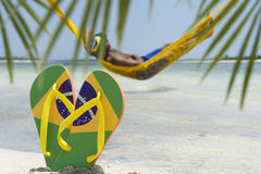 Man Relaxes in Hammock on Brazilian Beach Royalty Free Stock Images