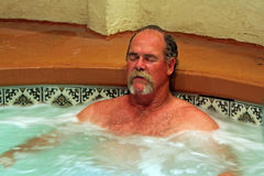 Man relaxes in jacuzzi spa Royalty Free Stock Images