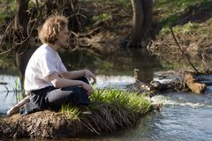 Man relaxing. Near small river Royalty Free Stock Images