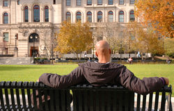 Man relaxing. In park on a sunny day Royalty Free Stock Photos