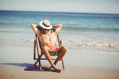 Man relaxing on armchair Stock Photo