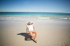 Man relaxing on armchair Royalty Free Stock Images