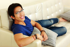 Free Man Relaxing At Home On The Sofa Royalty Free Stock Images - 43079009
