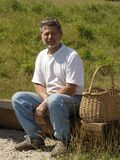 Man relaxing with baskets Royalty Free Stock Photo