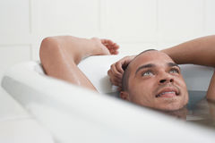 Man Relaxing In Bathtub Stock Images