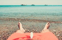 Man relaxing on the beach Royalty Free Stock Photo
