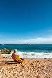Man relaxing at the beach Stock Image