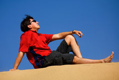 Man relaxing at the beach Royalty Free Stock Photo