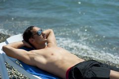 Man relaxing by the beach Stock Image