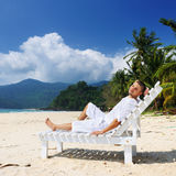 Man relaxing on a beach Stock Images