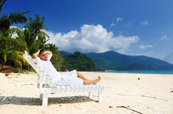 Man relaxing on a beach Stock Photo