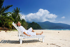 Man relaxing on a beach Royalty Free Stock Image