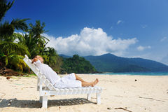 Man relaxing on a beach Royalty Free Stock Photos