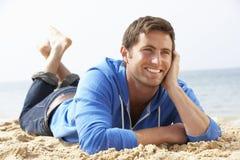 Man Relaxing On Beach Royalty Free Stock Photos
