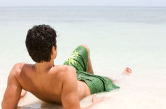 Man relaxing at the beach Stock Images