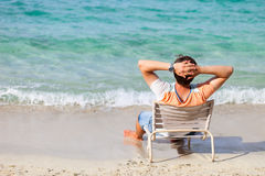 Man relaxing at beach Royalty Free Stock Image