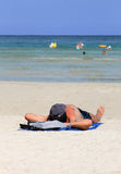 Man relaxing on beach in summer Stock Photos