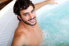 Man relaxing in a beauty farm Royalty Free Stock Image
