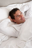 Man Relaxing In Bed Stock Photos